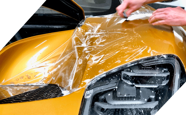paint protection film being applied to a car